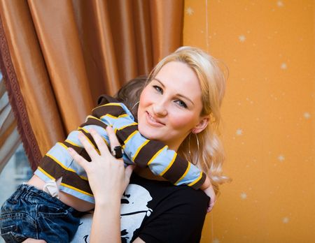 blondy: yong beautiful blondy woman holding the son in her arms