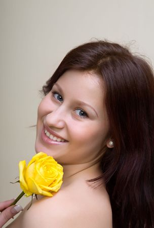 Portrait of the beautiful girl with a rose Stock Photo - 2779878