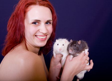 Portrait of the beautiful girl with two rats photo
