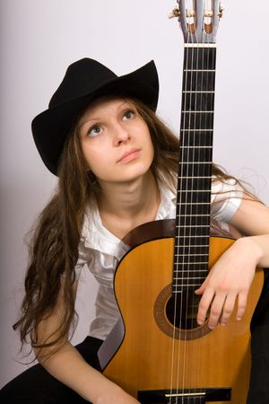 Portrait of the beautiful girl with a guitar photo