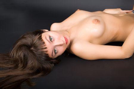 shirless voluptuous brunette lying on her back Stock Photo - 3297492