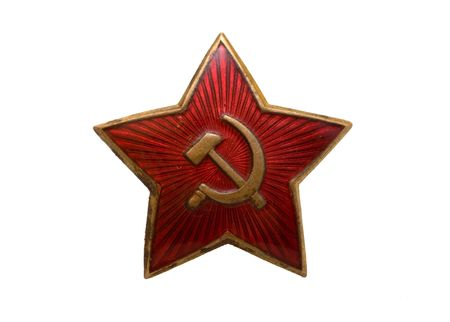 hammer and sickle: The Soviet badge with a sickle and a hammer Stock Photo