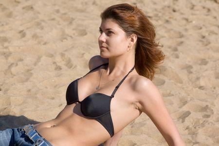 The girl on a beach against sand Stock Photo - 3748026
