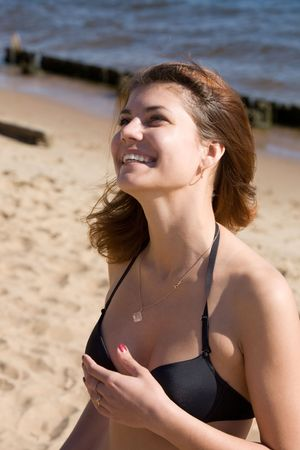 Portrait the smiling girl on a beach Stock Photo - 3748025