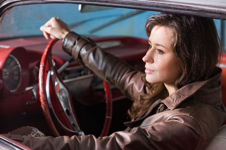 The beautiful girl at the wheel the retrocar Stock Photo - 3756572