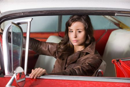 The beautiful girl at the wheel the retrocar Stock Photo - 3756573