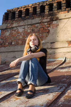 The beautiful girl with the camera on a roof Stock Photo - 3772824