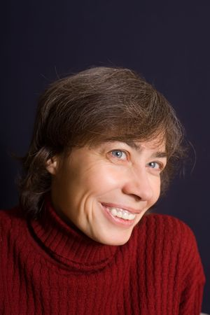 Portrait of the smiling woman in a dark red sweater Stock Photo - 3859841
