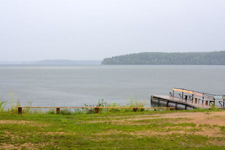 Wood lake in the end of a rain photo