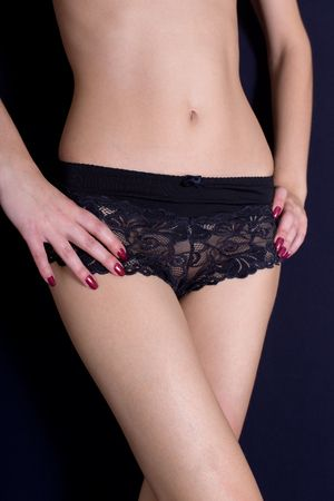 The bared girl in black shorts photo