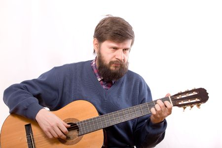 The man playing on acoustic guitar on white background photo