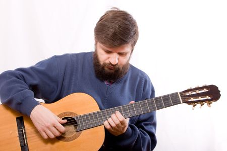 The man playing on acoustic guitar on white background Stock Photo - 4191153