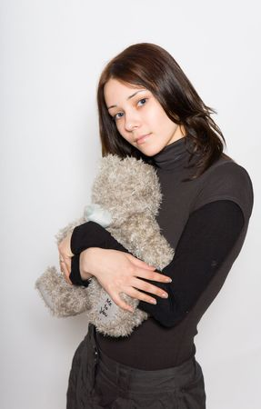 girl holding a teddy bear in her arms and looking at the viewer Stock Photo - 4205171