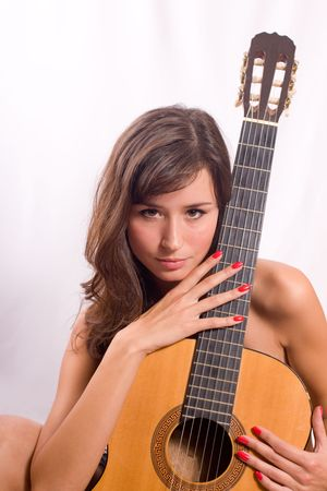 Portrait of the beautiful girl with a guitar Stock Photo - 4205177
