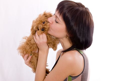 shaggy: The girl kisses a red shaggy puppy