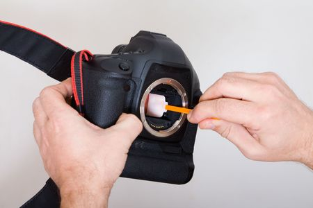 Cleaning of a digital camera sensor Stock Photo - 4307367