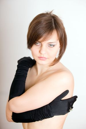 The young woman in gloves photo