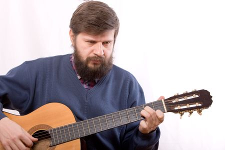 The man playing on acoustic guitar photo
