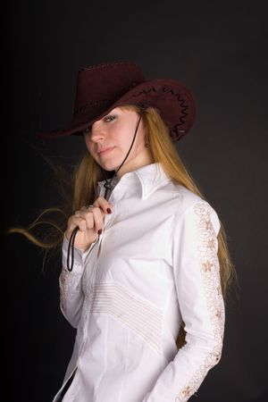 stetson: The young woman in a  brown stetson