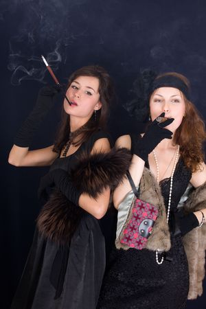 Portrait of two girls with a cigar and a cigarette photo