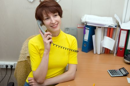 The manager at office speaks by phone Stock Photo - 5269570