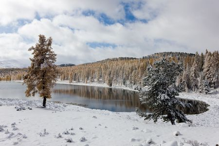 Winter landscape with lake in mountains, Altai photo