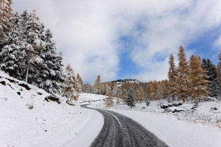 Twisting mountain road in snow day, Altai photo