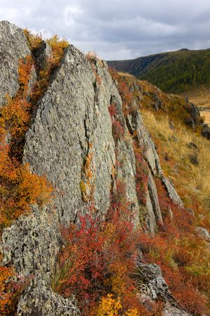 Rocks in mountains with bright autumn paints photo