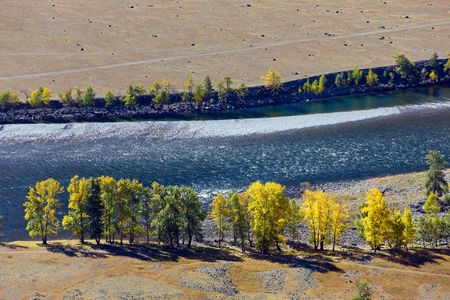 The mountain river in the autumn - the top view photo