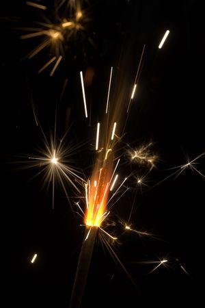 Burning celebratory fireworks on a black background photo