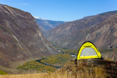 Tourist tent on a rock at precipice photo