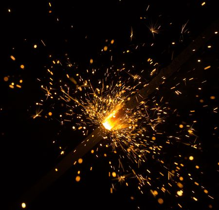 sparking: sparking Bengal fires on black background close-up Stock Photo