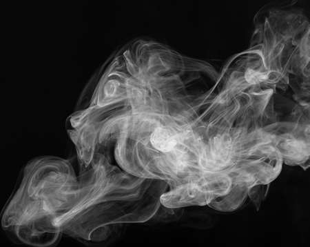 Cigarette smoke close up on a black background