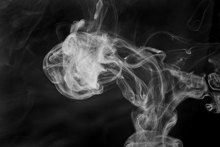 Cigarette smoke close up on a black background