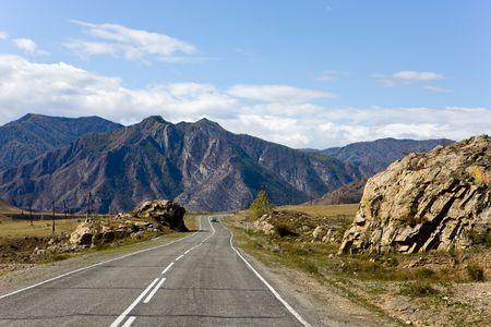 Mountain road in the autumn, Altai, Siberia, Russia Stock Photo - 6410968