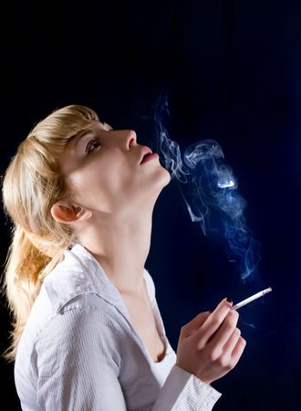 Portrait of the nice blonde with a cigarette photo