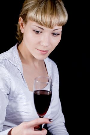The beautiful blonde with a red wine glass photo