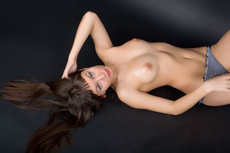 shirtless voluptuous brunette lying on her back Stock Photo - 7004668