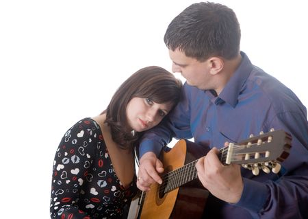 The man plays for darling on a guitar Stock Photo - 7097679