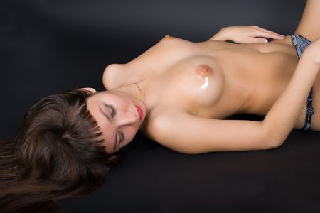 shirtless voluptuous woman lying on her back Stock Photo - 7168810