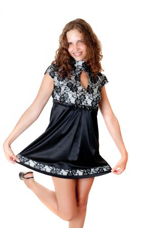 Portrait of the playful girl in a black dress photo