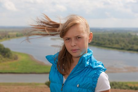 Portrait of the young girl in windy day photo