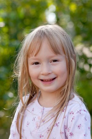 Portrait of the little girl on the nature Stock Photo - 7848510