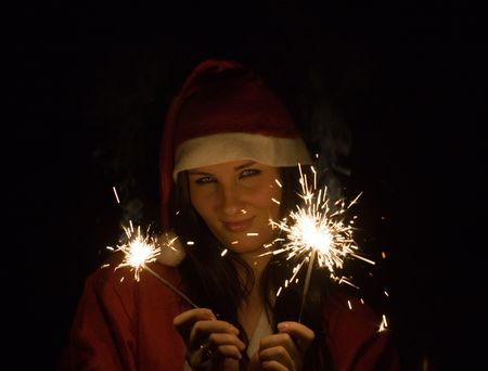 The girl in a suit of Santa Claus with Bengal fires photo