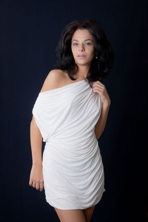 The beautiful brunette in a white dress photo