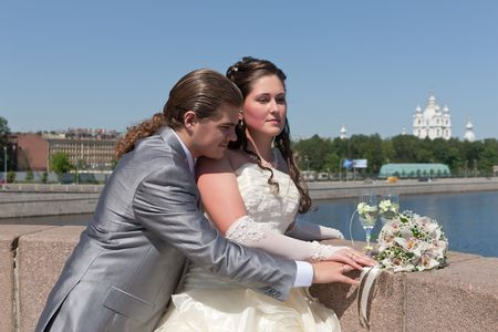 Newly-married couple on the bridge in St.-Petersburg photo