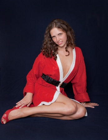 The sexy girl in a suit of Santa Claus Stock Photo - 8246424