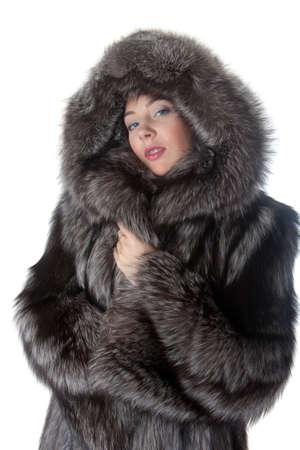 bata blanca: Retrato de la ni�a en un abrigo de piel Foto de archivo
