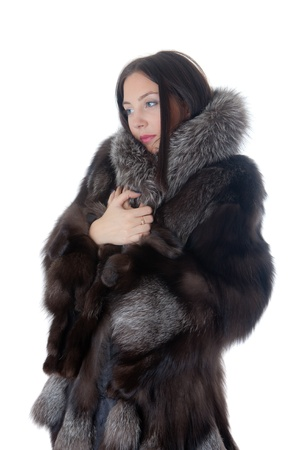 Portrait of the girl in a fur coat photo