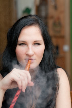 Portrait of the girl smoking a hookah photo